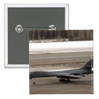 A B-1B Lancer performs a touch and go Pinback Button