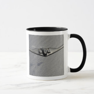 A B-2 Spirit flies over the Pacific Ocean Mug