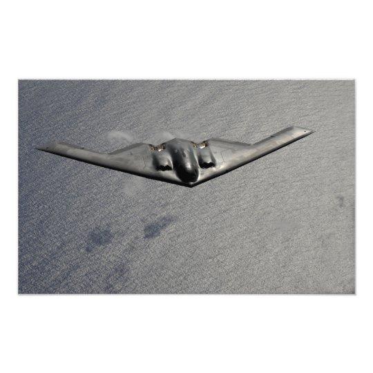 A B-2 Spirit flies over the Pacific Ocean Photo Print