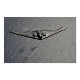 A B-2 Spirit flies over the Pacific Ocean Poster