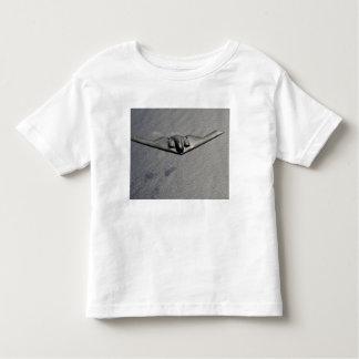 A B-2 Spirit flies over the Pacific Ocean Toddler T-shirt