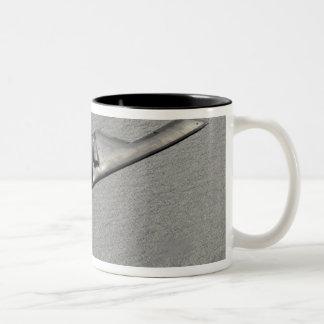 A B-2 Spirit flies over the Pacific Ocean Two-Tone Coffee Mug