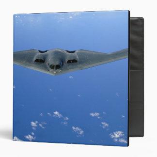 A B-2 Spirit soars through the sky 3 Ring Binder