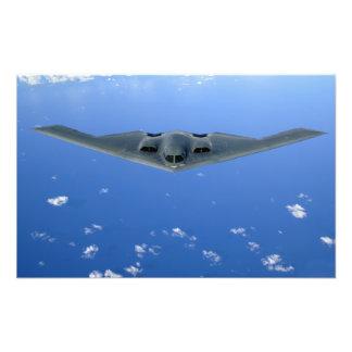 A B-2 Spirit soars through the sky Photo Print