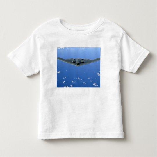 A B-2 Spirit soars through the sky Toddler T-shirt