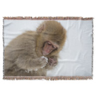 A baby Japanese Macaque (or snow monkey) Throw Blanket