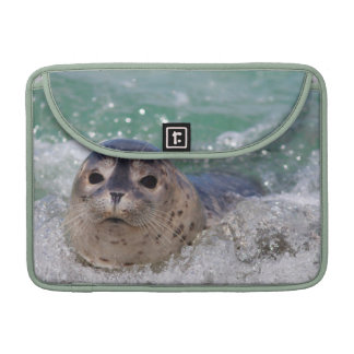 A baby seal surfing MacBook pro sleeves