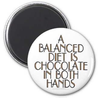 A balanced diet is chocolate in both hands 2 inch round magnet