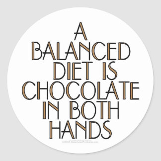 A balanced diet is chocolate in both hands classic round sticker