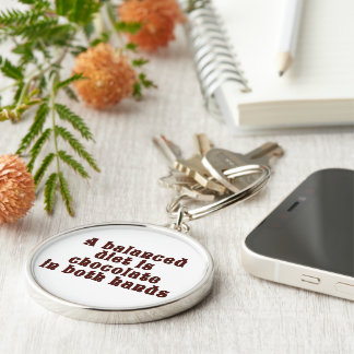 A balanced diet is chocolate in both hands keychain