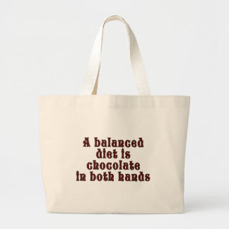 A balanced diet is chocolate in both hands large tote bag