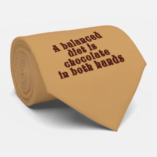 A balanced diet is chocolate in both hands neck tie