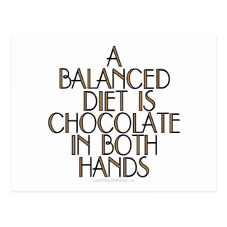 A balanced diet is chocolate in both hands postcard