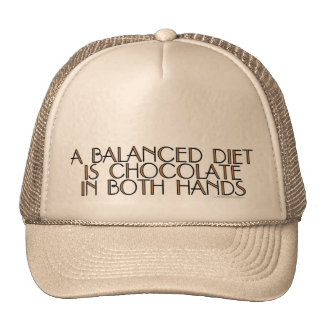 A balanced diet is chocolate in both hands trucker hat