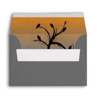 A Bare Tree with Silhouettes of Crows Envelope