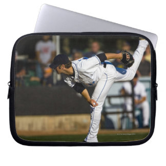 A baseball playing throwing the ball laptop sleeves