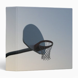 A basketball backboard hoop and net. Clear blue Binder