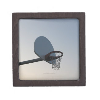 A basketball backboard hoop and net. Clear blue Jewelry Box