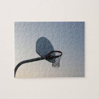 A basketball backboard hoop and net. Clear blue Jigsaw Puzzle