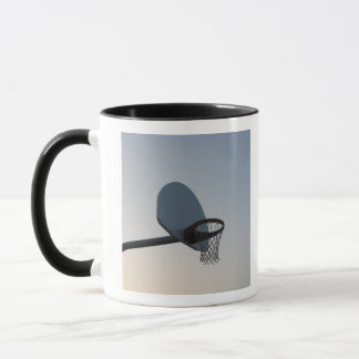 A basketball backboard hoop and net. Clear blue Mug