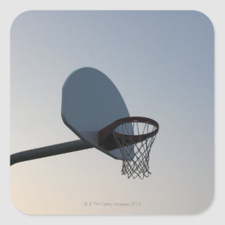 A basketball backboard hoop and net. Clear blue Square Sticker