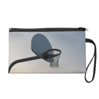 A basketball backboard hoop and net. Clear blue Wristlet Purse