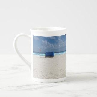 A Beach Chair Awaits Tea Cup