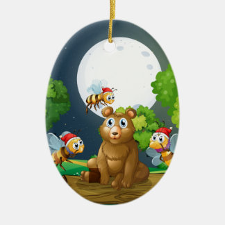 A bear above the log surrounded with Santa bees Ceramic Ornament