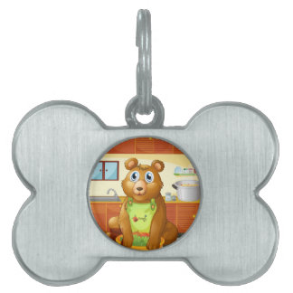 A bear holding a bowl of vegetables inside the kit pet tags