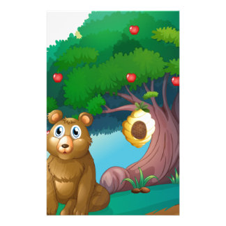 A bear in front of a big apple tree with a beehive stationery