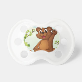 A bear sitting on a wood baby pacifiers