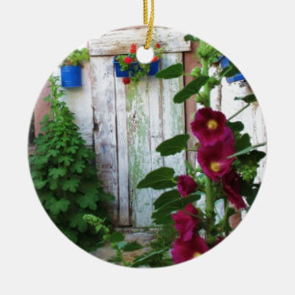 A beautiful rustic old blue door in a wild garden Double-Sided ceramic round christmas ornament