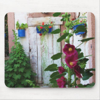 A beautiful rustic old blue door in a wild garden mouse pad