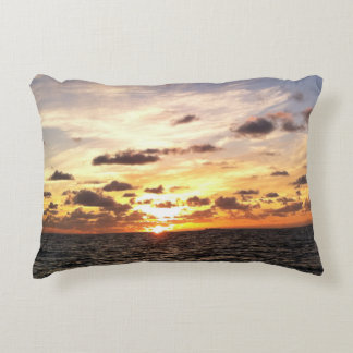 A beautiful sunrise over the ocean on this pillow