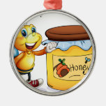 A bee beside the jar of honey metal ornament