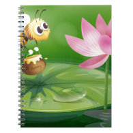 A bee with a pot of honey above a waterlily notebook