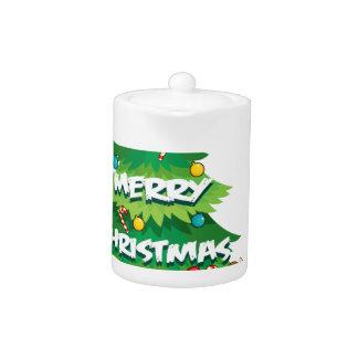 A big christmas tree beside the reindeer hugging t teapot