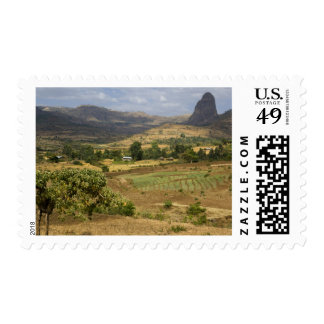 A big scenic view of a big rock mountain postage