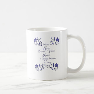 A bird does not sing because .. coffee mug