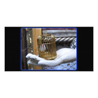A bird in a cage photo card