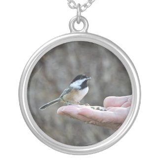 A Bird in the Hand Necklaces