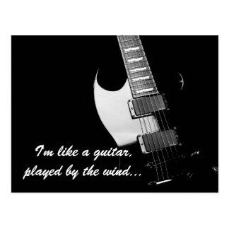 A black guitar postcard