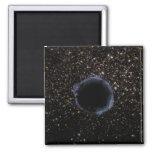A Black Hole in a Globular Cluster Fridge Magnets