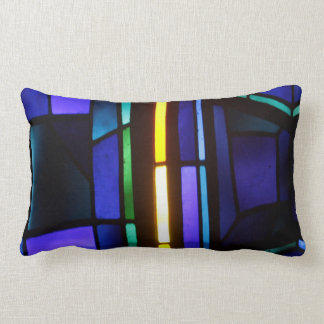 A blue abstract collage lumbar pillow