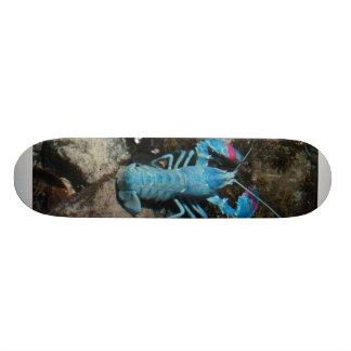 A blue lobster on the bottom of skateboard. skateboard