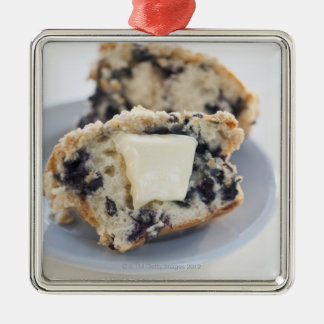 A blueberry muffin with butter christmas ornaments