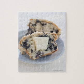 A blueberry muffin with butter puzzle