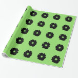 A Bold Black Flower on Green Gift Wrapping Paper