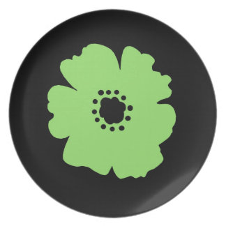 A Bold Green Flower on Black Plates