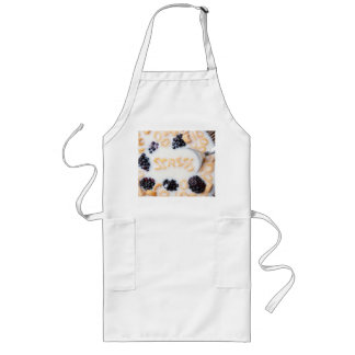 A bowl of alphabet cereal pieces floating in milk long apron